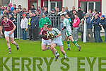 Dromid's forwards on the defence as Niall O'Shea tries to prevent Kanturk's Shane Walsh from getting the ball away.