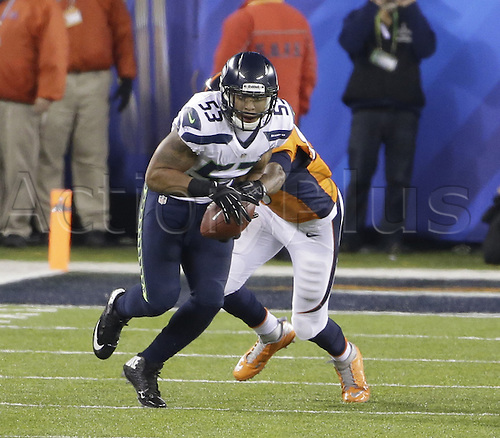 02.02.2014. East Rutherford, NJ, USA. Malcolm Smith (53) of the Seattle Seahawks returns a fumble recovery against the Denver Broncos during the second half of Super Bowl XLVIII at MetLife Stadium in East Rutherford, N.J., on Sunday, Feb. 2, 2014