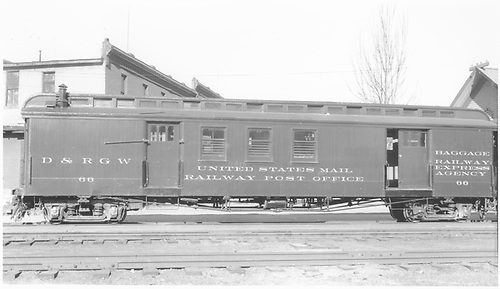 #66 baggage &amp; RPO combine car at Durango.  Side view.<br /> D&amp;RGW  Durango, CO  Taken by Dunscomb, Guy L. - 5/5/1942