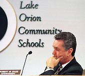"Contemplation: Lake Orion schools Superintendent Robert Bass is leaving the district after eight years of service.  Athough the board of education says his resignation comes ""with regret,""  Bass's tenure and relationship with the board has had its share of controversy.  In fact, many community members believe feuding between Bass and board members prompted his early retirement."