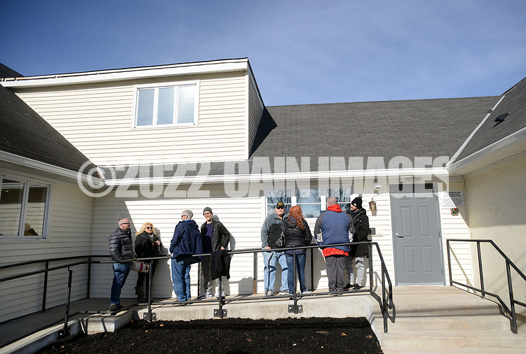 Patients wait in line outside TerraVida Holistic Center, which is one of the first medical marijuana dispensary's in Pennsylvania to open Saturday, February 17, 2018 in Sellersville, Pennsylvania. (WILLIAM THOMAS CAIN / For The Inquirer)