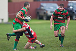 Kelepi Aholelei looks for support from skipper Grant Henson as he is tackled. Counties Manukau Premier Club Rugby game between Waiuku & Karaka played at Waiuku on Saturday July 4th 2009. Waiuku won the game 22 - 7.