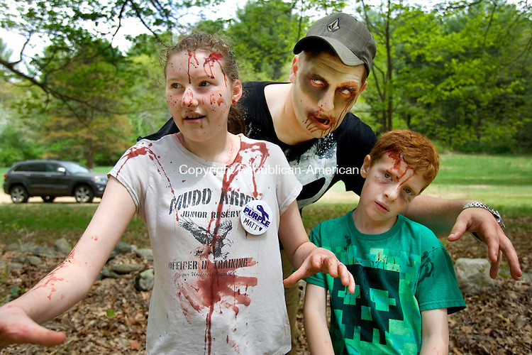 WASHINGTON CT. 09 May 2015-050915SV09-Pete Collins of New Milford with his sister, Autumn Collins, 13, left, and son Gabriel Collins, 8, at right, wait for runners during the 5K Zombie Run Against Epilepsy at the Steep Rock Preserve in Washington Depot Saturday.<br /> Steven Valenti Republican-American