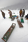 Sled wallahs (workers) at the ski fields of Gulmarg in the disputed northern Indian state of Kashmir.  60 kilometres from the capital city of Srinagar, tourists are drawn from all over the world for the comparatively cheap skiing and Indian winter experience. Gulmarg also boasts the worlds highest gondola that transports snow bunnies up a lung busting 4200 metres.