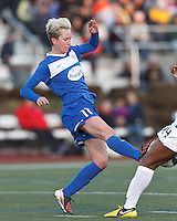 Under pressure, Boston Breakers midfielder Joanna Lohman (11) passes the ball.  In a National Women's Soccer League Elite (NWSL) match, the Boston Breakers (blue) tied the Washington Spirit (white), 1-1, at Dilboy Stadium on April 14, 2012.