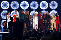 "Maren Morris, from left, Katy Perry, Jimi Westbrook, Kimberly Schlapman, Dolly Parton, Karen Fairchild, Philip Sweet, Miley Cyrus and Kacey Musgraves perform ""9 to 5"" at the 61st annual Grammy Awards on Sunday, Feb. 10, 2019, in Los Angeles. (Photo by Matt Sayles/Invision/AP)"
