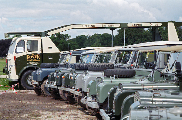 A line up of historic 1950s Land Rover Series 1 and a Leyland car transporter at the 1998 Land Rover Series 1 Club event in Shugborough, UK. The transporter was used by Land Rover to dispatch their cars in the 50's. NO RELEASES AVAILABLE. Automotive trademarks are the property of the trademark holder, authorization may be needed for some uses.