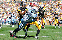 PITTSBURGH, PA - OCTOBER 09:  Nate Washington #85 of the Tennessee Titans attempts to handle a catch in front of Ike Taylor #24 and Troy Polamalu #43 of the Pittsburgh Steelers during the game on October 9, 2011 at Heinz Field in Pittsburgh, Pennsylvania.  (Photo by Jared Wickerham/Getty Images)