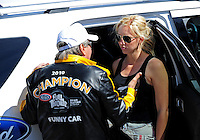 Apr. 4, 2011; Las Vegas, NV, USA: NHRA funny car driver Courtney Force (right) talks with father John Force during testing at The Strip in Las Vegas. Mandatory Credit: Mark J. Rebilas-