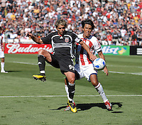 DC United forward Jaime Moreno (99) gets a pass from a teammate while being cover from behind by Chivas USA defender Claudio Suarez (2). DC United defeated Chivas USA 2-1, at RFK Stadium in Washington DC, Sunday May 6, 2007.