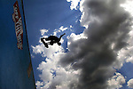 Professional skateboard Neil Hendrix gets some lofty air above the Van's Warped Tour half pipe during the annual sports & music show held at Old Bridge Twp. Raceway Park on Aug. 11, 2004<br />