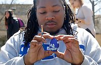 NWA Democrat-Gazette/DAVID GOTTSCHALK Chancellor Shepard, a sophomore at the University of Arkansas, looks at the his decorated egg Friday, March 30, 2018, during the 2nd Annual Painting with an Eggs-Stra Twist on the Union Mall on campus in Fayetteville. Shepard painted the colors of his fraternity Phi Beta Sigma Fraternity, Inc. at the event hosted by University Programs that also hosted the 4th Annual Egg-Stravagent Hunt that took place earlier in the day.