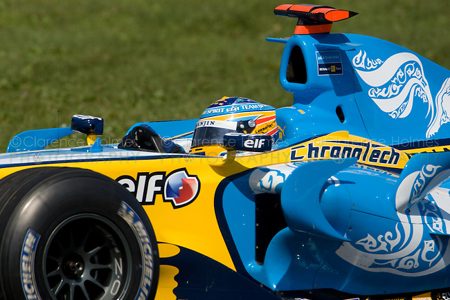 MONTREAL - JUNE 24: Fernando Alonso of Renault in the Senna complex of turns 1 and 2 during the practice session on the Saturday of race weekend of the Canadian F1 Grand Prix at the Circuit Gilles-Villeneuve June 24, 2006 in Montreal, Canada.