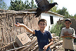 Boys play with their pet pigeons in a camp for internally displaced people from Nagorno-Karabakh, in the Agdam region of Azerbaijan.