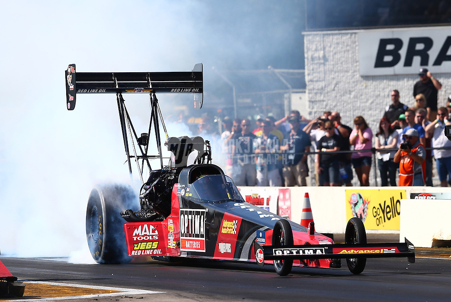 Aug. 17, 2013; Brainerd, MN, USA: NHRA top fuel dragster driver David Grubnic during qualifying for the Lucas Oil Nationals at Brainerd International Raceway. Mandatory Credit: Mark J. Rebilas-