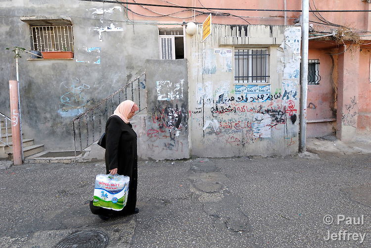 A woman walks through the Daheisheh Refugee Camp in Bethlehem.