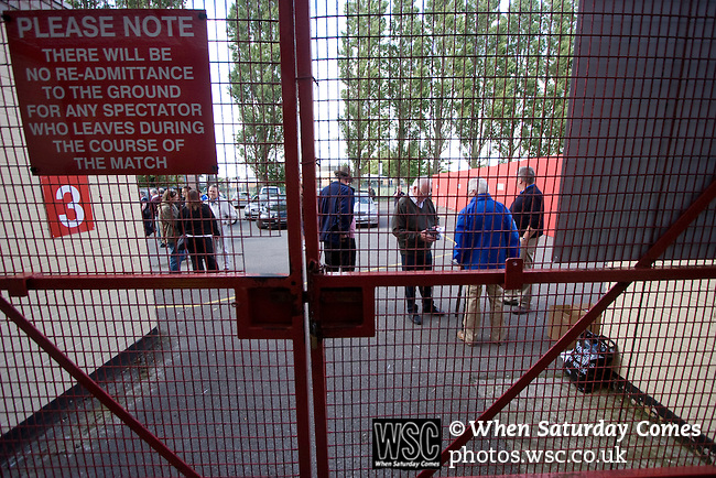 Bangor City 0 FC Honka 1, 23/07/2009. Racecourse Ground, Europa League. Bangor City supporters waiting for the gates to open outside Wrexham's Racecourse Ground, the venue for their sides Europa League second round second leg tie against FC Honka from Finland. The match had to be staged away from City's Farrar Road ground as it did not meet UEFA's stadium standards. The Finns won 1-0 in Wales to go through 3-0 on aggregate in front of 602 spectators in the first season of the newly-introduced competition which replaced the UEFA Cup. Photo by Colin McPherson.