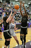 Fayetteville's Caroline Lyles (23) takes a shot Friday, Jan. 17, 2020, as she is pressured by Bentonville's Maryam Dauda (right) and Bella Irlenborn (left) during the first half of play in Bulldog Arena in Fayetteville. Visit nwaonline.com/prepbball/ for a gallery from the games.<br /> (NWA Democrat-Gazette/Andy Shupe)