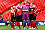 LONDON, ENGLAND - MARCH 29: Wrexham players in a huddle before the FA Carlsberg Trophy Final 2015 at Wembley Stadium on March 29, 2054 in London, England. (Photo by Dacid Horn/EAP)
