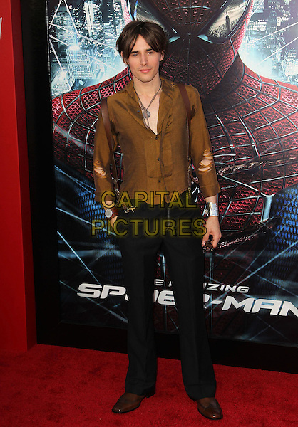 "Reeve Carney.Los Angeles Premiere Of ""The Amazing Spider-Man"" Held The at Regency Village Theatre, Westwood, California, USA..June 28th, 2012.full length black trousers brown shirt ripped torn sleeves .CAP/ADM/FS.©Faye Sadou/AdMedia/Capital Pictures."