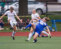Sky Blue FC defender Madeleine Thompson (25) traps the ball as Boston Breakers midfielder Maddy Evans (18) tries to tackle her.  In a National Women's Soccer League Elite (NWSL) match, Sky Blue FC defeated the Boston Breakers, 3-2, at Dilboy Stadium on June 16, 2013
