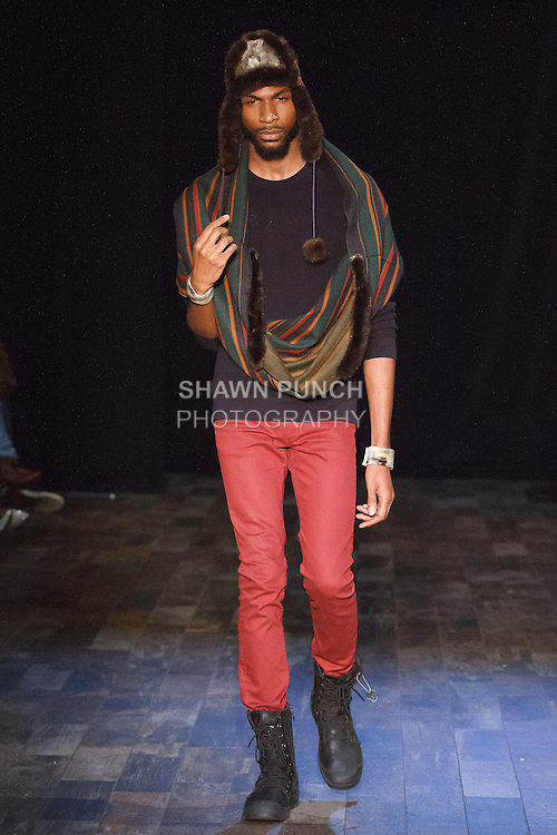 Model walks runway in an outfit from the Shaman Furs collection by Peter Williams at 26 Bridge Street on May 6, 2016, during Fashion Week Brooklyn's 10 year anniversary.