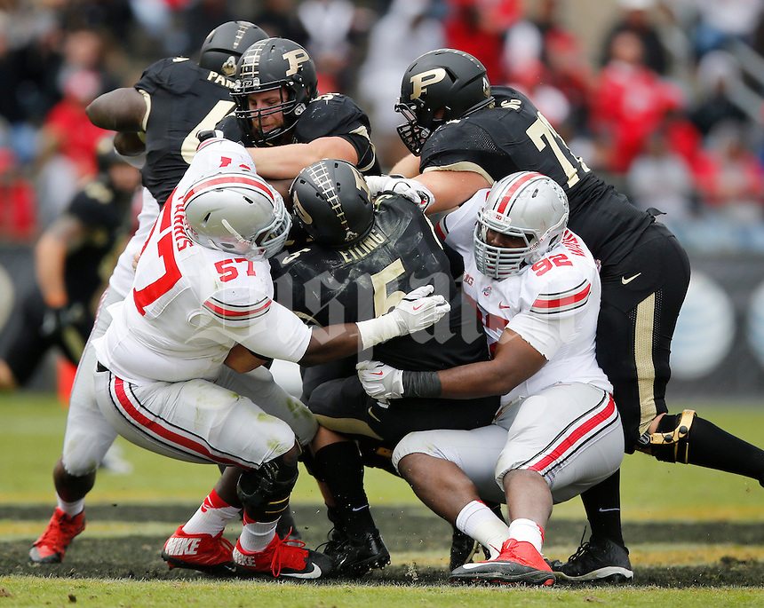 Ohio State Buckeyes offensive linesman Chase Farris (57) and defensive lineman Adolphus Washington (92) sack Purdue Boilermakers quarterback Danny Etling (5) during the fourth quarter of the NCAA football game at Ross-Ade Stadium in West Lafayette, Ind. on Nov. 2, 2013. (Adam Cairns / The Columbus Dispatch)