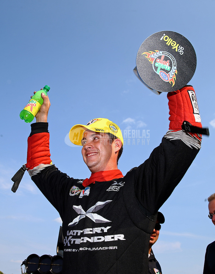 Aug. 18, 2013; Brainerd, MN, USA: NHRA top fuel dragster driver Spencer Massey celebrates after winning the Lucas Oil Nationals at Brainerd International Raceway. Mandatory Credit: Mark J. Rebilas-