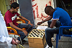 Tripoli - Libya - 11 October 2013 -- Two young men play a game of chess in the Old City of Tripoli. -- PHOTO: Iason ATHANASIADIS /  EUP-IMAGES