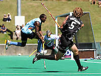 India's Vikram Pillay tries to block Andrew Hayward's pass across goal during the international hockey match between the New Zealand Black Sticks and India at National Hockey Stadium, Wellington, New Zealand on Saturday, 20 February 2009. Photo: Dave Lintott / lintottphoto.co.nz
