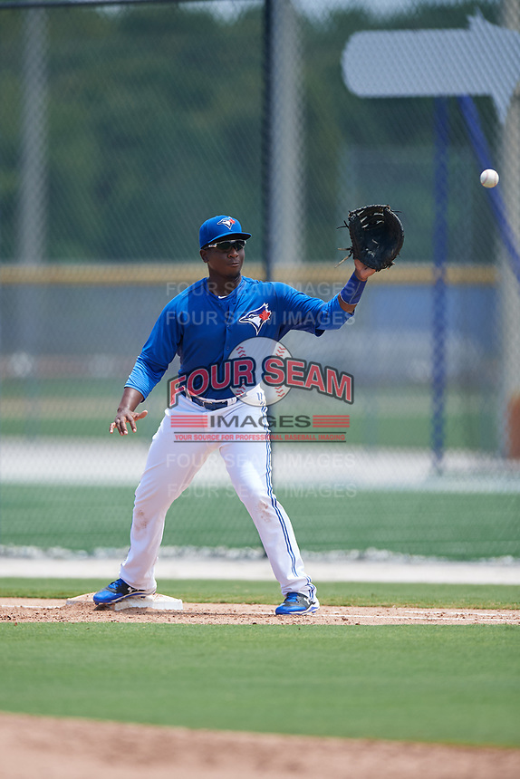 GCL Blue Jays first baseman Yhordegny Kelly (49) waits to receive a throw during a game against the GCL Pirates on July 20, 2017 at Bobby Mattick Training Center at Englebert Complex in Dunedin, Florida.  GCL Pirates defeated the GCL Blue Jays 11-6 in eleven innings.  (Mike Janes/Four Seam Images)