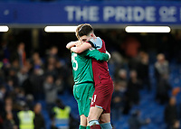 30th November 2019; Stamford Bridge, London, England; English Premier League Football, Chelsea versus West Ham United; Goalkeeper David Martin of West Ham United celebrates with  Declan Rice after full time as West Ham United beat Chelsea 0-1 at Stamford Bridge  - Strictly Editorial Use Only. No use with unauthorized audio, video, data, fixture lists, club/league logos or 'live' services. Online in-match use limited to 120 images, no video emulation. No use in betting, games or single club/league/player publications