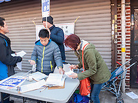 Voter registration on Eighth Avenue in the Sunset Park neighborhood in Brooklyn in New York on Sunday, February 28, 2016 during the Lantern Festival street fair. Sunset Park has become Brooklyn's Chinatown as Chinese and other Asian groups have moved there and businesses have sprouted up to cater to them. (© Richard B. Levine)