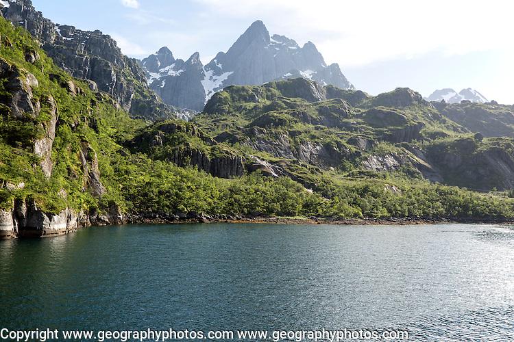 Steep sided glacial trough fiord jagged mountain peaks, Trollfjorden, Lofoten Islands, Nordland, northern, Norway