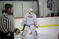 Men's D2 hockey team plays Elon University at the Lahaye Ice Center on September 20, 2013. (Photo by Kevin Manguiob)