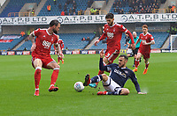 Lee Gregory of Millwall challenges Danny Fox of Nottingham Forest (left) and Tobias Figueiredo of Nottingham Forest for the ball during the Sky Bet Championship match between Millwall and Nottingham Forest at The Den, London, England on 30 March 2018. Photo by Alan  Stanford / PRiME Media Images.