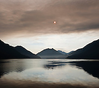Smoke blocks sun over Lake Crescent, Olympic national park, Washington, USA