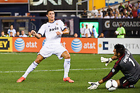 Cristiano Ronaldo (7) of Real Madrid beats A. C. Milan goalkeeper Marco Amelia (1) for his second goal. Real Madrid defeated A. C. Milan 5-1 during a 2012 Herbalife World Football Challenge match at Yankee Stadium in New York, NY, on August 8, 2012.