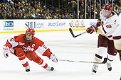 Joe Pereira (BU - 6), Brian Dumoulin (BC - 2) - The Boston College Eagles defeated the Boston University Terriers 3-2 (OT) in their Beanpot opener on Monday, February 7, 2011, at TD Garden in Boston, Massachusetts.