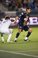 Philadelphia Union forward Carlos Ruiz (20) gives ex team mate LA Galaxy Todd Dunivant (2) a help up. The LA Galaxy defeated the Philadelphia Union 1-0 at Home Depot Center stadium in Carson, California on  April  2, 2011....