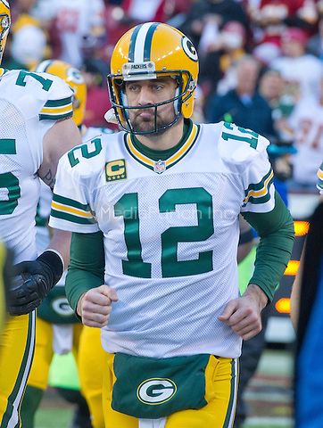 Green Bay Packers quarterback Aaron Rodgers (12) runs onto the field as his team is introduced prior to the NFC Wild Card game against the Washington Redskins at FedEx Field in Landover, Maryland on Sunday, January 10, 2016.<br /> Credit: Ron Sachs / CNP/MediaPunch ***FOR EDITORIAL USE ONLY***