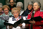 TORRINGTON, CT- 01 JANUARY 2006-0101067JS02-Members and friends of Holy Trinity Lutheran Church and Sacred Heart Roman Catholic Church, including Elizabeth Neri, (in white) and Susan Zbell, right, both of Torrington, sing &quot;Nad Tatrou sa blyska&quot; the National Anthem of the Slozak Republic during the 14th annual anniversary of the Slovak Republic Monday at the steps of City Hall in Torrington. Zbell came to the United States from the Slovak Republica in 1939 at the age of 15. The commemoration of the 14th anniversary of the Slovak Republic was sopnsored by the Slavic Hertiage Institute of Torrington.  <br /> Jim Shannon/Republican-American