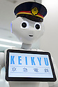 SoftBank's humanoid robot Pepper debuted as a new member of staff for the Keikyu Line railway at Haneda International Terminal station on November 28, 2015, Tokyo, Japan. Pepper is programmed to interact with Japanese and foreign commuters and to introduce Keiyu Line information. (Photo by Rodrigo Reyes Marin/AFLO)