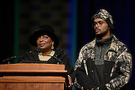 Washington, DC - December 6, 2014: Cora Masters Barry, widow of former mayor Marion Barry Jr., speaks at the memorial service for her late husband, December 6, 2014, as Barry's son Christopher looks on. Thousands gathered at the Washington Convention Center to remember Barry's life as a civil rights activist, chair of the Student Nonviolent Coordinating Committee (SNCC), and a four-term mayor.  (Photo by Don Baxter/Media Images International)