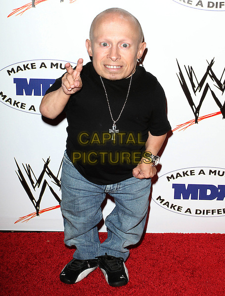 VERNE TROYER .WWE SummerSlam Kickoff Party held at The Tropicana Bar, Hollywood, CA, USA..August 13th, 2010.full length black t-shirt jeans denim hand in pocket v peace sign .CAP/ADM/KB.©Kevan Brooks/AdMedia/Capital Pictures.
