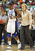 Duke guard Karima Christmas is helped off the court after a bad fall. This game was one of the two Semifinal games of the 2011 ACC Tournament in Greensboro on Saturday, March 5, 2011. Duke beat Georgia Tech 74-66. (Photo by Al Drago)