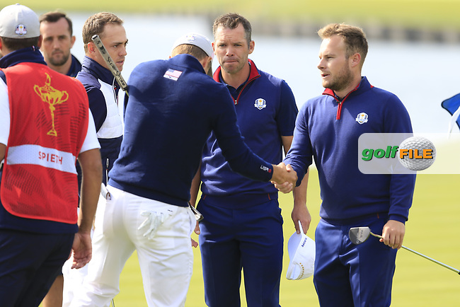 Justin Thomas and Jordan Spieth Team USA win their match 1up against Paul Casey and Tyrrell Hatton Team Europe on the 18th green during Friday's Fourball Matches at the 2018 Ryder Cup, Le Golf National, Iles-de-France, France. 28/09/2018.<br /> Picture Eoin Clarke / Golffile.ie<br /> <br /> All photo usage must carry mandatory copyright credit (© Golffile | Eoin Clarke)