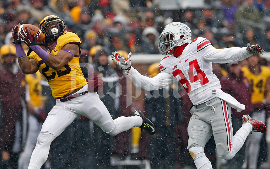 Minnesota Golden Gophers defensive back Briean Boddy-Calhoun (29) makes an interception against Ohio State Buckeyes wide receiver Corey Smith (84) during the 1st quarter at TCF Bank Stadium in Minneapolis, Minn. on November 15, 2014.  (Dispatch photo by Kyle Robertson)