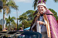 Naples Mayor Bill Barnett tosses beads to parade-goers along Main Street during the Mardi Gras-themed fourth annual Mardi Paws Parade and Pet Fest, hosted by the Collier Spay Neuter Clinic, at the Mercato  Shopping Center, Naples, Florida, USA, Feb. 26, 2011. Photo by Debi Pittman Wilkey