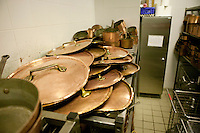 Copper pots, pans, saucepans and lids sit on shelves in a in a storage room kitchen at the Gregoire Ferrandi cooking school in Paris, France, 17 December 2007.
